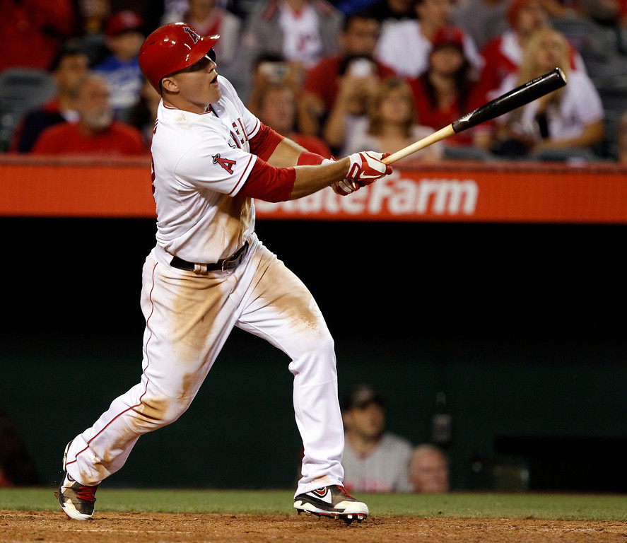. Los Angeles Angels\' Mike Trout hits a solo home run in the eighth inning, to hit for the cycle against the Seattle Mariners during a baseball game Tuesday, May 21, 2013 in Anaheim.  The Angels won the game 12-0.   (AP Photo/Alex Gallardo)
