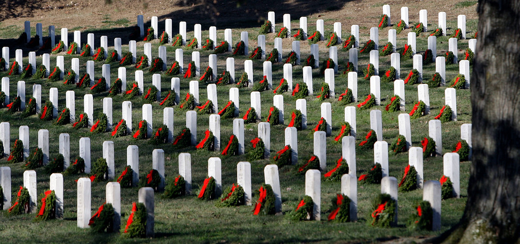 . Wreaths are seen at graves as part of Wreaths Across America at Arlington National Cemetery in Arlington, Va., Saturday, Dec. 12, 2009. More than 16,000 wreaths were placed at graves throughout the cemetery. (AP Photo/Alex Brandon)