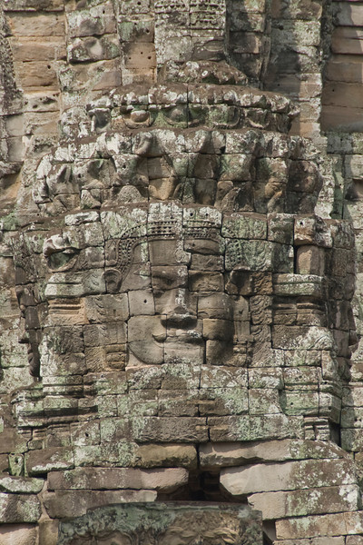 Head carved at the wall of Bayon Temple in Cambodia