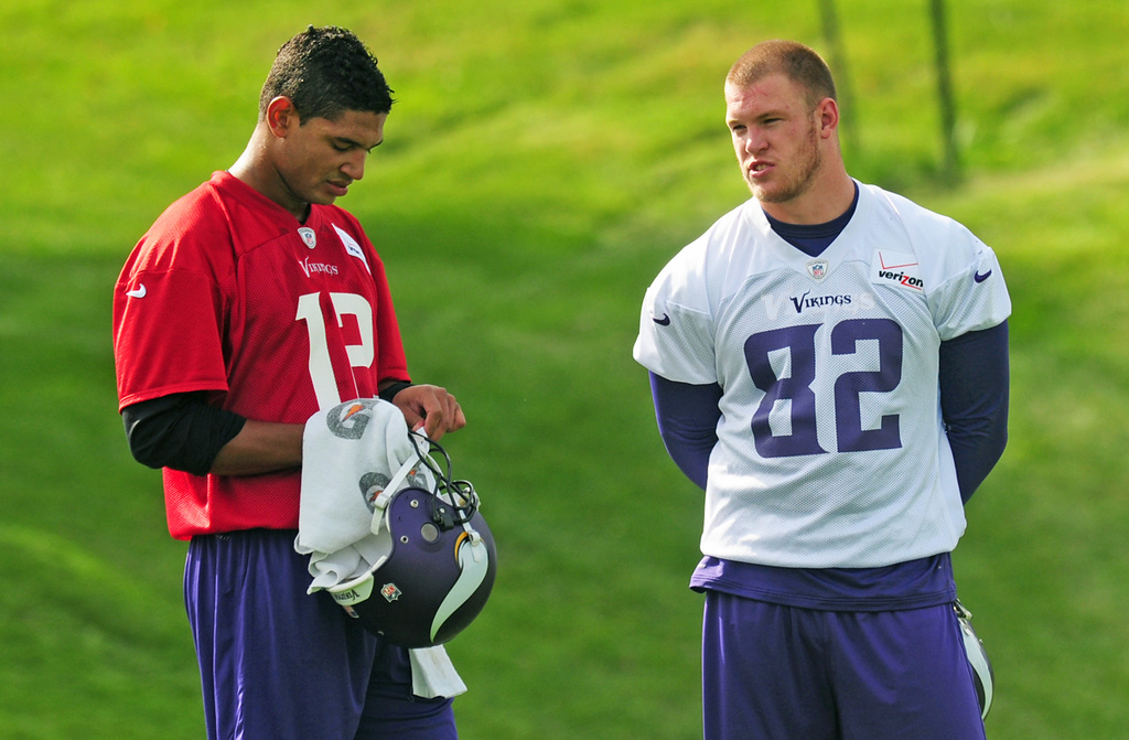 . New Vikings quarterback Josh Freeman, left, chats with tight end Kyle Rudolph chat during a lull in practice.  (Pioneer Press: Scott Takushi)