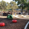 pea pod and tomato sculptures and concrete path maze with timber posts