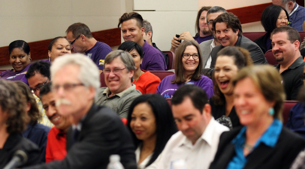. Applause breaks out among BART workers and union members as Vincent Harrington, counsel for SEIU, presents his testimony bringing about a rare lighter moment during the public hearing before a state panel commissioned by Gov. Jerry Brown at the Elihu M. Harris State Building in Oakland, Calif., on Wednesday, Aug. 7, 2013. (Laura A. Oda/Bay Area News Group)