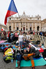 Pilgrims gather in St. Peter's Square at Vatican in advance of canonization of Blesseds John XXIII and John Paul II
