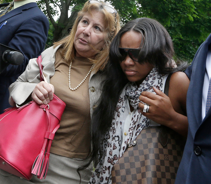 . Shayanna Jenkins, right, fiancee of former New England Patriots football player Aaron Hernandez, is escorted by attorney Janice Bassil after a bail hearing in Fall River Superior Court Thursday, June 27, 2013 in Fall River, Mass. Hernandez, charged with murdering Odin Lloyd, a 27-year-old semi-pro football player, was denied bail. (AP Photo/Elise Amendola)