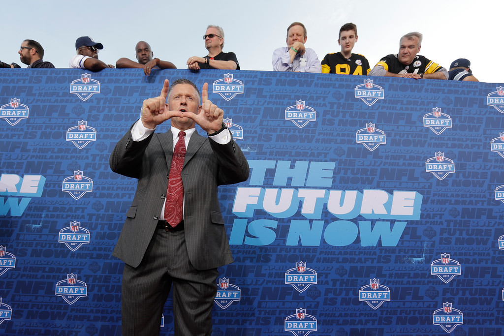 . Utah coach Kyle Whittingham arrives for the first round of the 2017 NFL football draft, Thursday, April 27, 2017, in Philadelphia. (AP Photo/Julio Cortez)