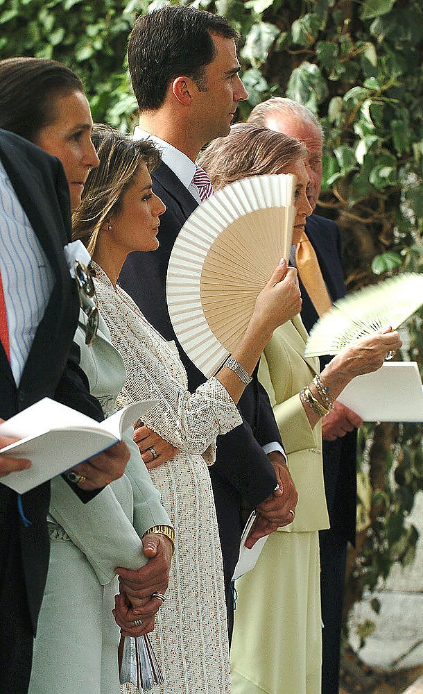 Description of . Prince Felipe of Spain and his wife Princess Letizia of Spain attend the Christening of their niece, Princess Irene, the daughter of Princess Cristina of Spain (the Duchess of Palma), and her husband Inaki Urdangarin at the Palacio de la Zarzuela on July 14, 2005 in Madrid, Spain.  The royal couple's first girl and fourth child is ninth in the line of succession to the throne.  (Photo by Angel Diaz/Getty Images)