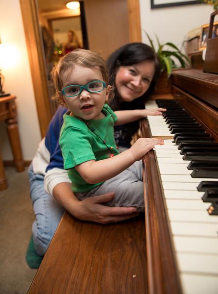 Mom and Caleb at the piano.jpg