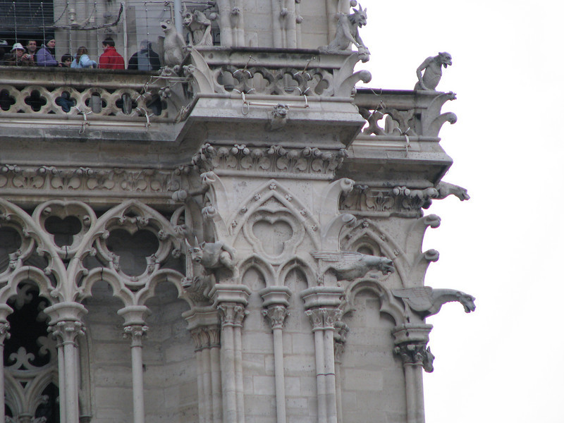 The Gargoyles on Notre Dame.  They have two functions:  they act as drainspouts and keep away evil spirits.