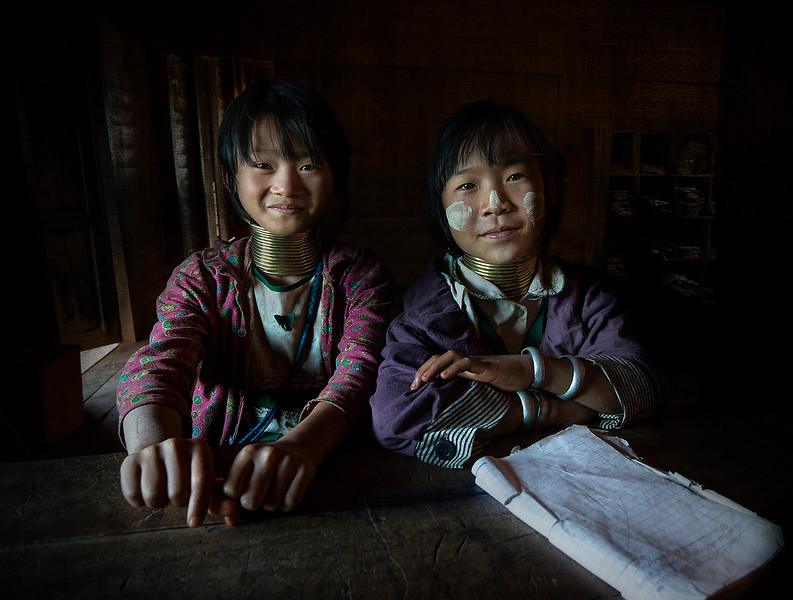 Two young girls from the Kayan tribe in their school classroom.  Kayah State, Myanmar, 2017.
