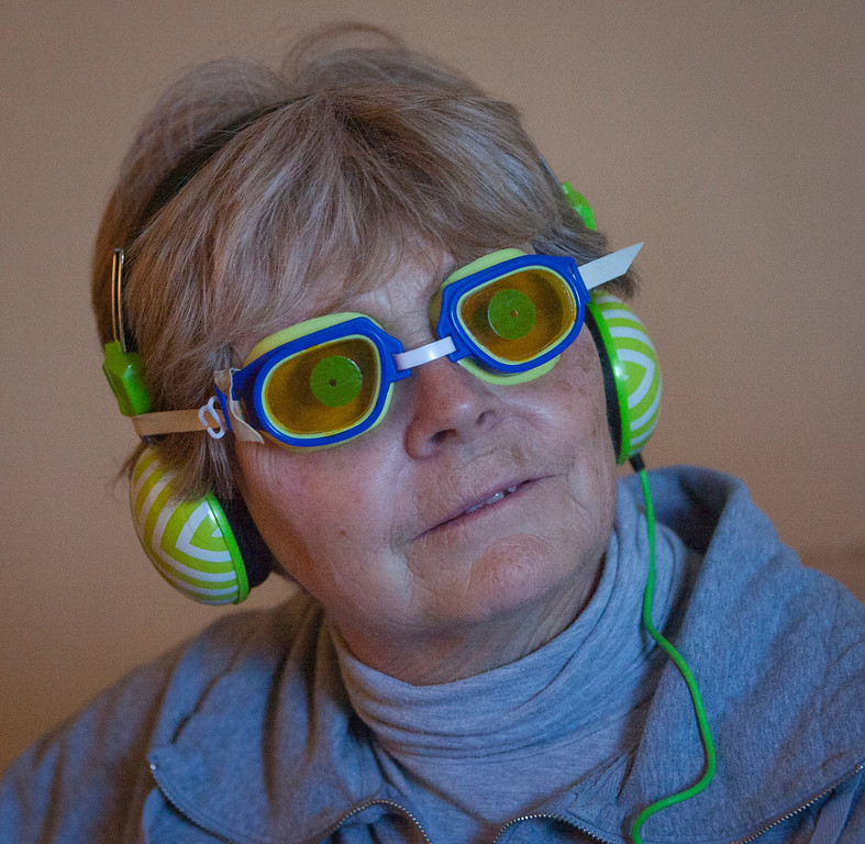 . Sally Cooley wears thick goggles as she takes the four minute virtual dementia tour at Atria Burlingame in Burlingame, Calif. on Saturday, Feb. 9, 2013. (John Green/Staff)