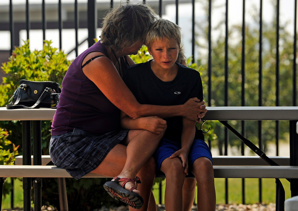 . A family sits outside The Ranch in Loveland, Tuesday, June 12, 2012, after evacuees of the High Park fire had a community meeting to learn more about the fast moving fire. RJ Sangosti, The Denver Post