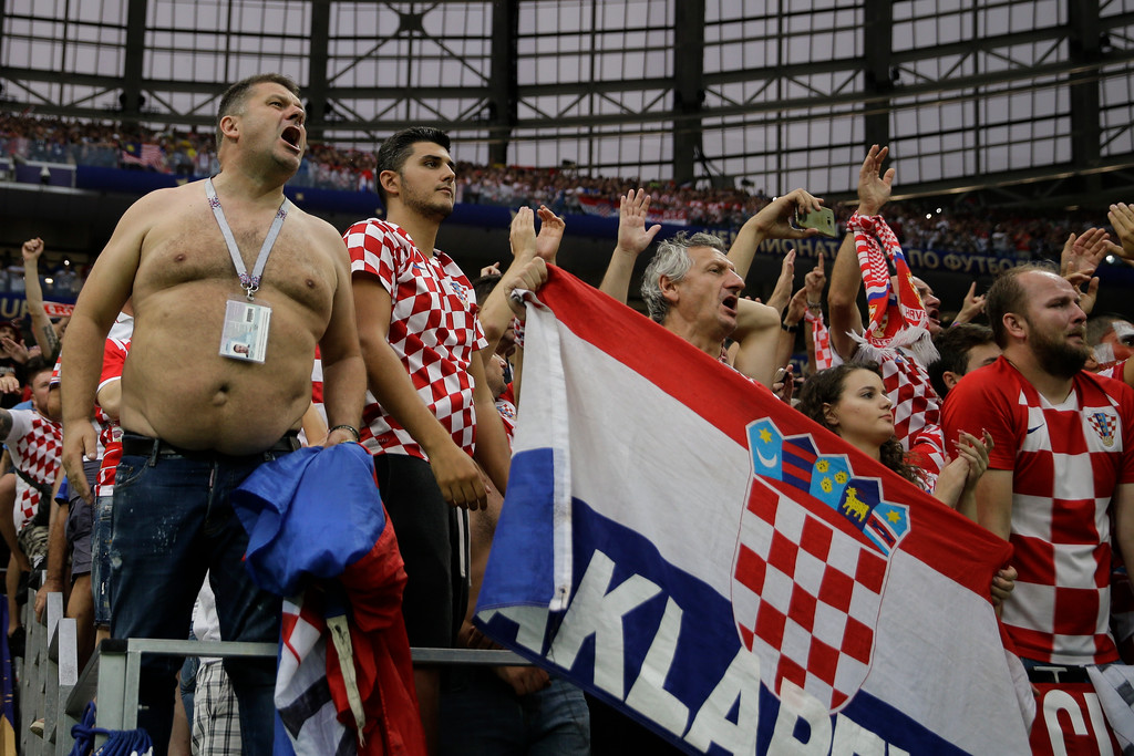 . Croatian fans at the end of the final match between France and Croatia at the 2018 soccer World Cup in the Luzhniki Stadium in Moscow, Russia, Sunday, July 15, 2018. (AP Photo/Natacha Pisarenko)