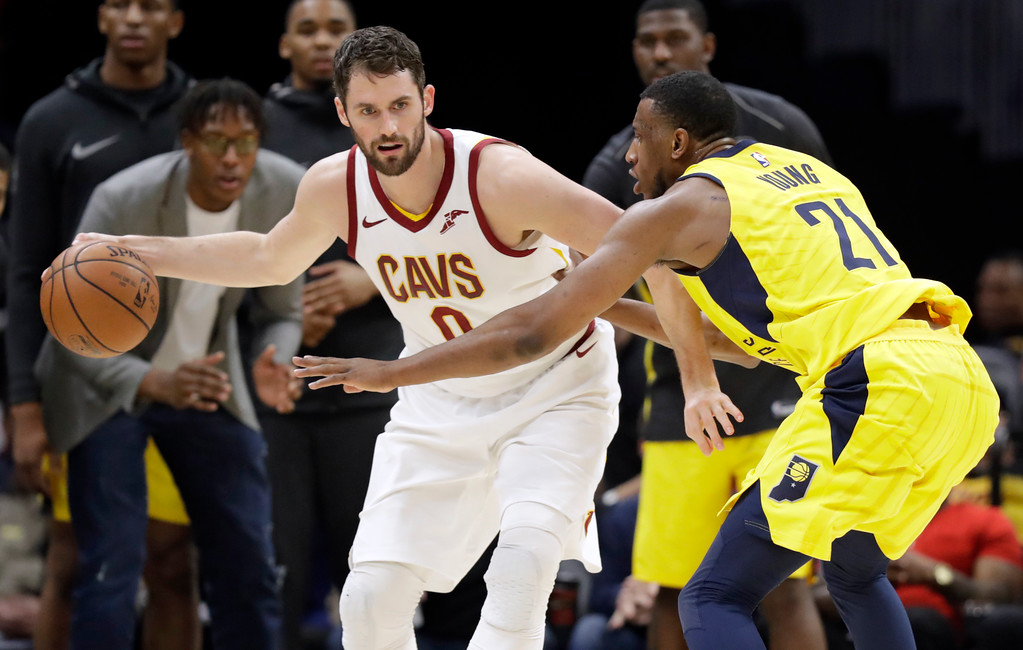 . Cleveland Cavaliers\' Kevin Love (0) drives against Indiana Pacers\' Thaddeus Young (21) in the second half of an NBA basketball game, Friday, Jan. 26, 2018, in Cleveland. (AP Photo/Tony Dejak)