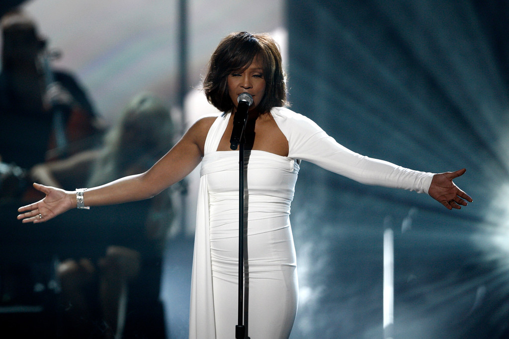 . File - Whitney Houston performs at the 37th Annual American Music Awards on Sunday, Nov. 22, 2009, in Los Angeles. Houston was born August 9, 1963 in Newark, New Jersey and died February 11, 2012, in Beverly Hills, California at the age of 48. (AP Photo/Matt Sayles)