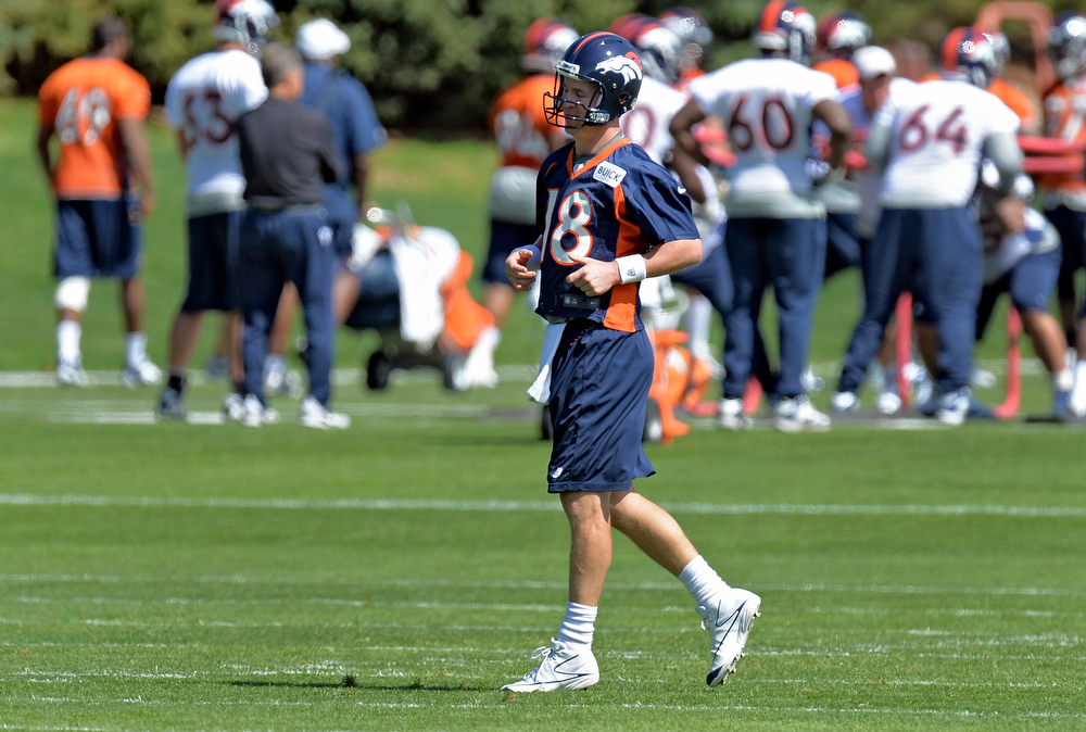 . Peyton Manning (18) of the Denver Broncos during the teams OTAs May 20, 2013 at Dove Valley. All offseason training activities (OTAs) are voluntary until the mandatory minicamp June 11-13. (Photo By John Leyba/The Denver Post)