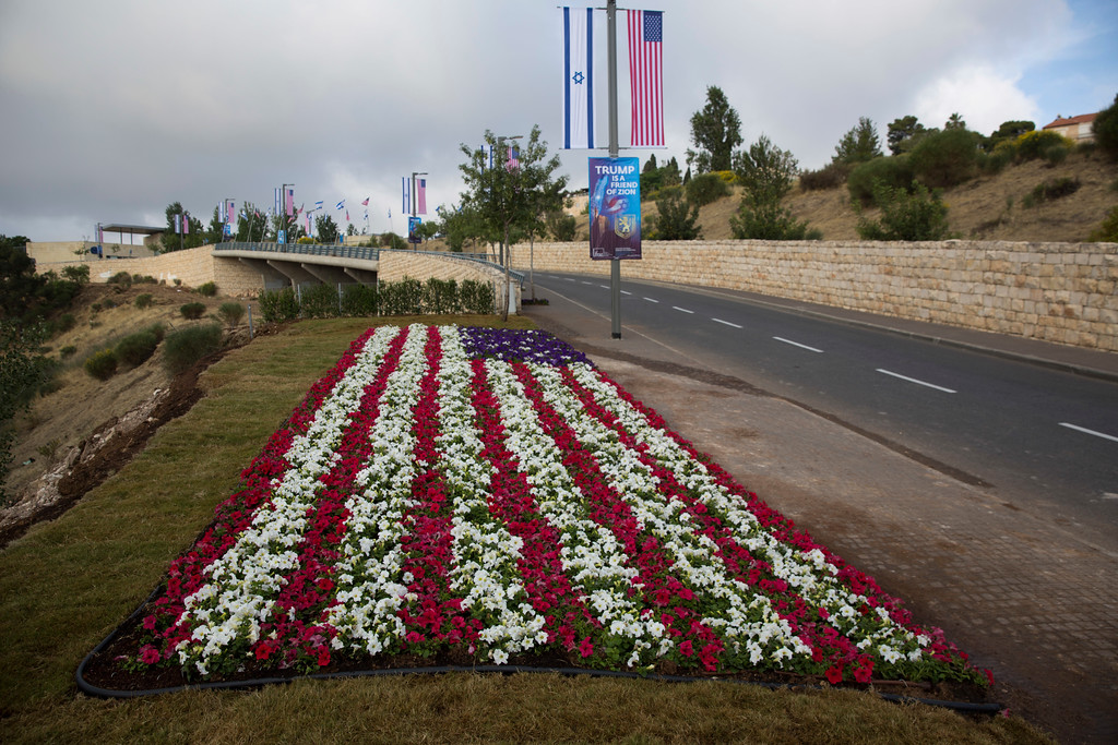. Flowers decorated as an American flag are seen on a road leading to the US Embassy compound ahead the official opening in Jerusalem, Sunday, May 13, 2018. On Monday, the United States moves its embassy in Israel from Tel Aviv to Jerusalem, the holy city at the explosive core of the Israeli-Palestinian conflict and claimed by both sides as a capital. The inauguration comes five months after President Donald Trump recognized Jerusalem as Israel\'s capital. (AP Photo/Ariel Schalit)
