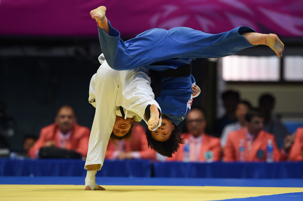 . Joung Da-Woon (bottom) of South Korea fights with Kim Sug-Yong (top) of North Korea during their women\'s judo team quarter-final of the 2014 Incheon Asian Games in Incheon on September 23, 2014.ED JONES/AFP/Getty Images