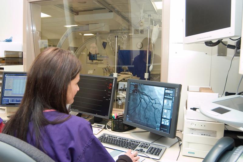 nurse analyzes x-ray machine