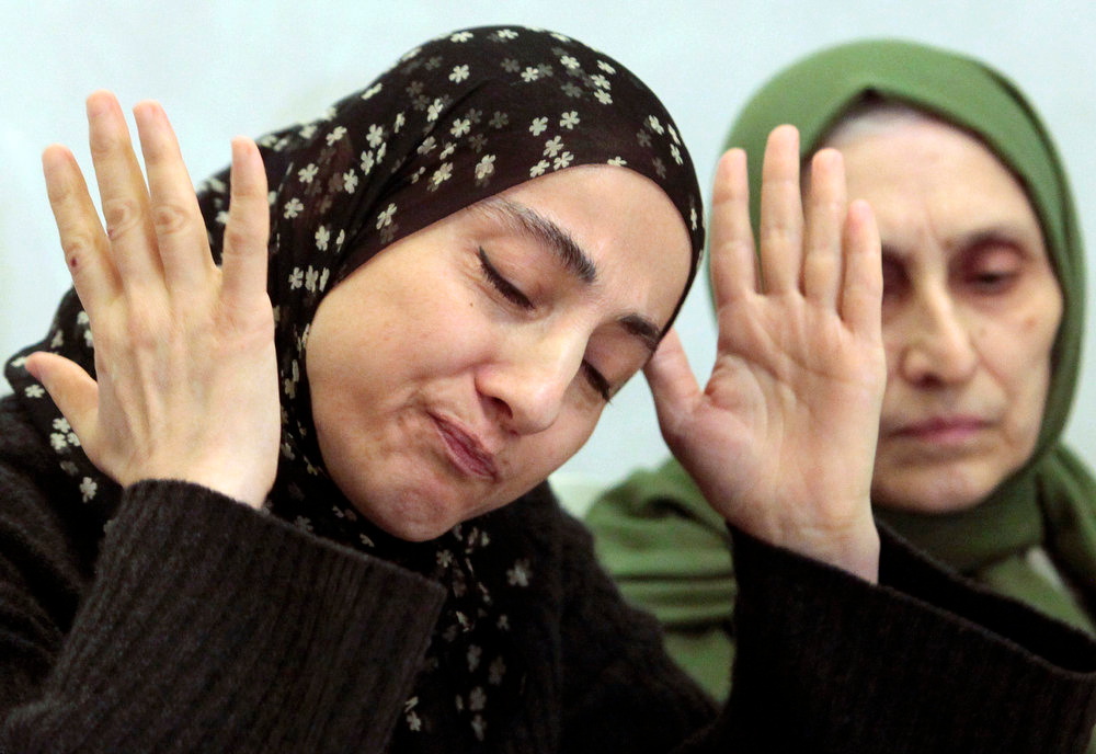 . Zubeidat Tsarnaeva, the mother of the two Boston bombing suspects, speaks at a news conference as her sister-in-law, Maryam, listens in Makhachkala, in the southern Russian province of Dagestan, Thursday, April 25, 2013. The suspects\' father, Anzor Tsarnaev, said Thursday that he is leaving Russia for the United States in the next day or two, but their mother said she was still thinking it over. (AP Photo/Musa Sadulayev)