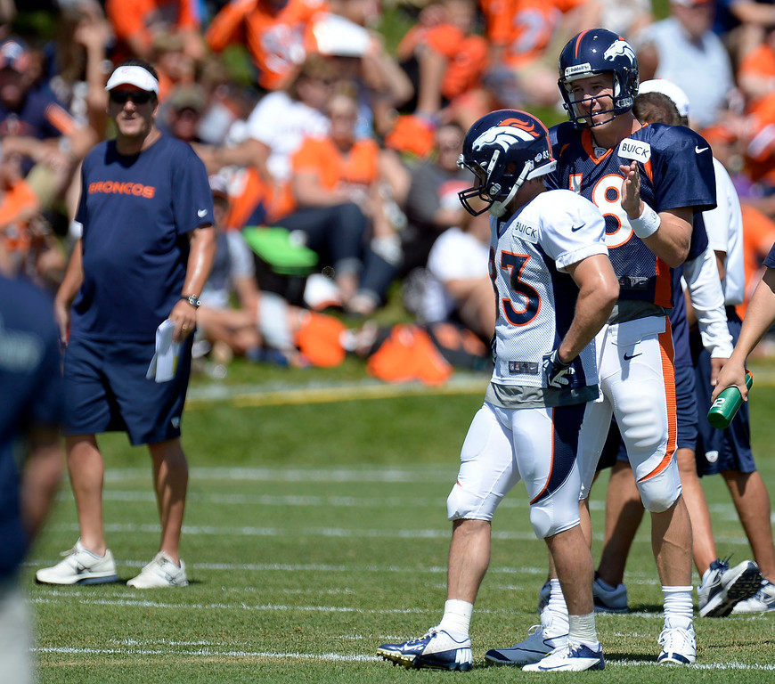 . Denver Broncos QB Peyton Manning (18) gives directions to WR Wes Welker (83) during training camp August 5, 2013 at Dove Valley. (Photo By John Leyba/The Denver Post)