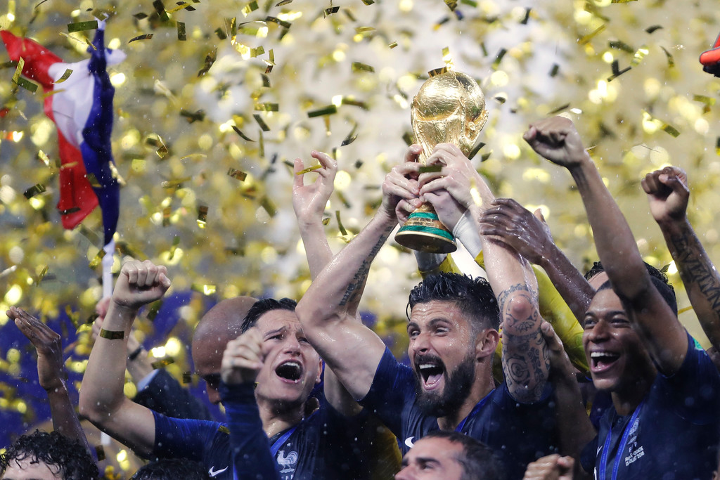. France\'s Olivier Giroud olds the trophy after the final match between France and Croatia at the 2018 soccer World Cup in the Luzhniki Stadium in Moscow, Russia, Sunday, July 15, 2018. (AP Photo/Natacha Pisarenko)