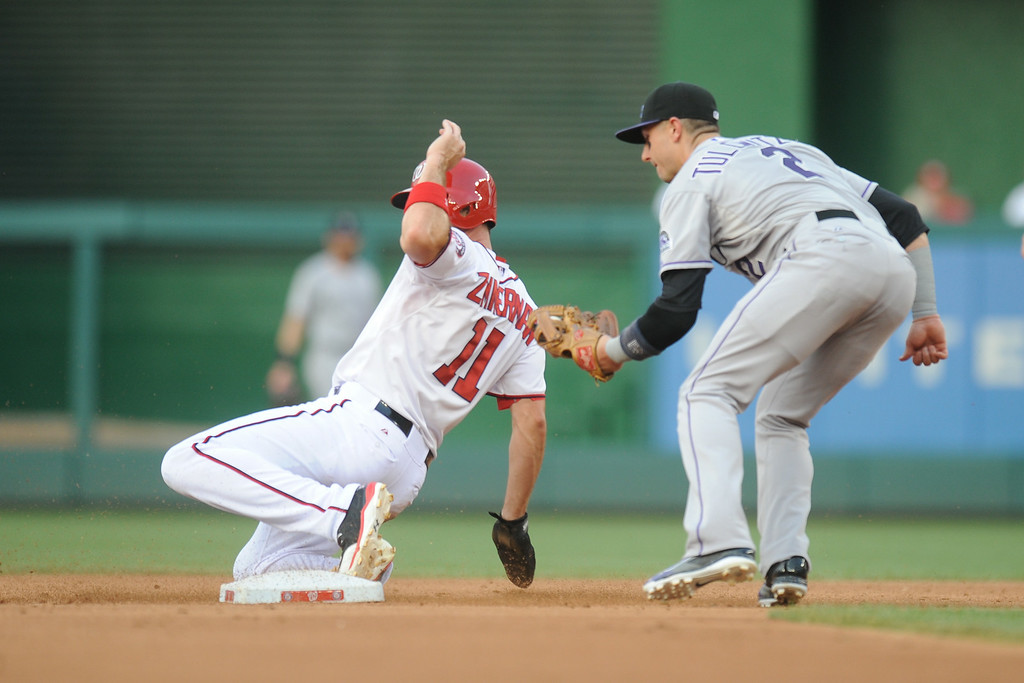 . Troy Tulowitzki #2 of the Colorado Rockies forces out Ryan Zimmerman #11 of the Washington Nationals at second base in the second inning during a baseball on July 2, 2014 at Nationals Park in Washington, DC. (Photo by Mitchell Layton/Getty Images)