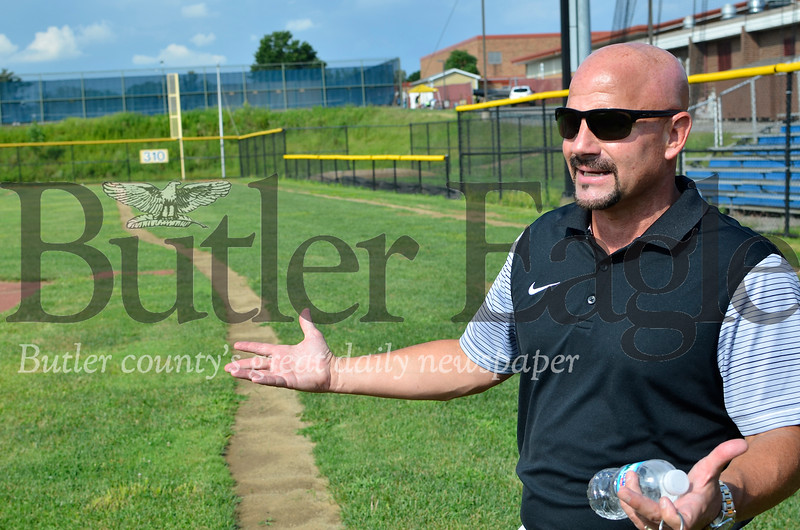 Butler athletic director Bill Mylan shows off the school district's remade baseball field. It's one of several athletic facility improvements done over the summer. Tanner Cole/Butler Eagle