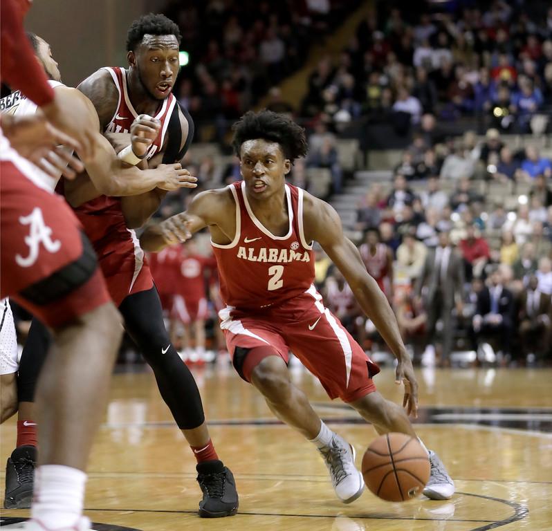 . Alabama guard Collin Sexton (2) plays against Vanderbilt in the first half of an NCAA college basketball game Tuesday, Jan. 2, 2018, in Nashville, Tenn. (AP Photo/Mark Humphrey)