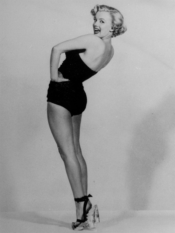 . In this undated file photo, actress Marilyn Monroe is pictured mimicking Betty Grable\'s famous World War II pin-up pose. (AP Photo, File)