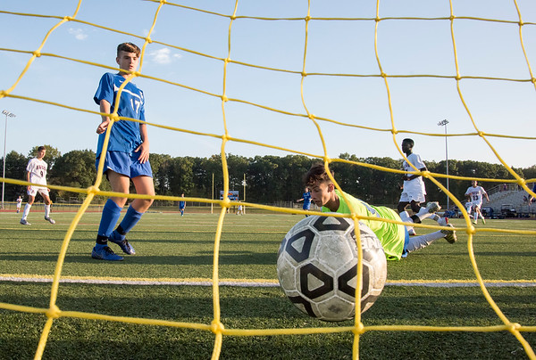 10/01/19 Wesley Bunnell   StaffrrSouthington boys soccer was defeated by Avon 3-2 on Tuesday afternoon at Southington High School. Trevor Sousa (17) and goal keeper Ryan Lunn (99) look back at the net after an Avon goal.
