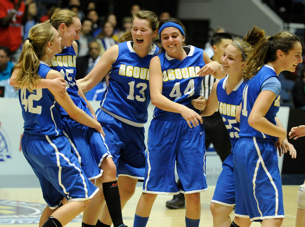 . Agoura celebrates on the floor after they defeated Gahr 60-39 in the CIF-SS Division III-AAA Girls Basketball Championship at the Anaheim Convention Center in Anaheim, CA 2/23/2013(John McCoy/Staff Photographer)