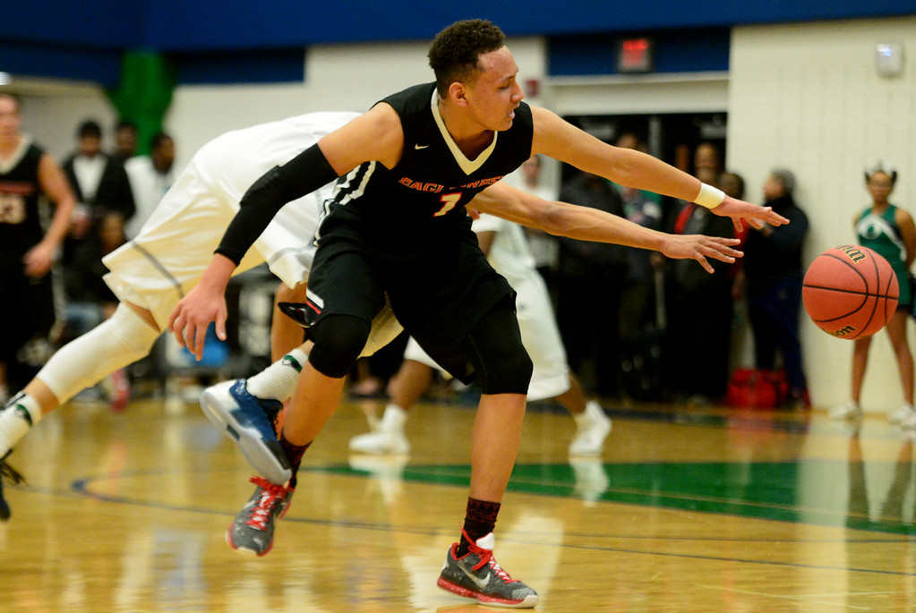 . Colbey Ross (1) of EagleCrest  and Daijon Smith (12) of Overland vie for a loose ball during the first half of play. The Overland Trailblazers hosted the Eaglecrest Raptors on Friday, January 8, 2016. (Photo by AAron Ontiveroz/The Denver Post)