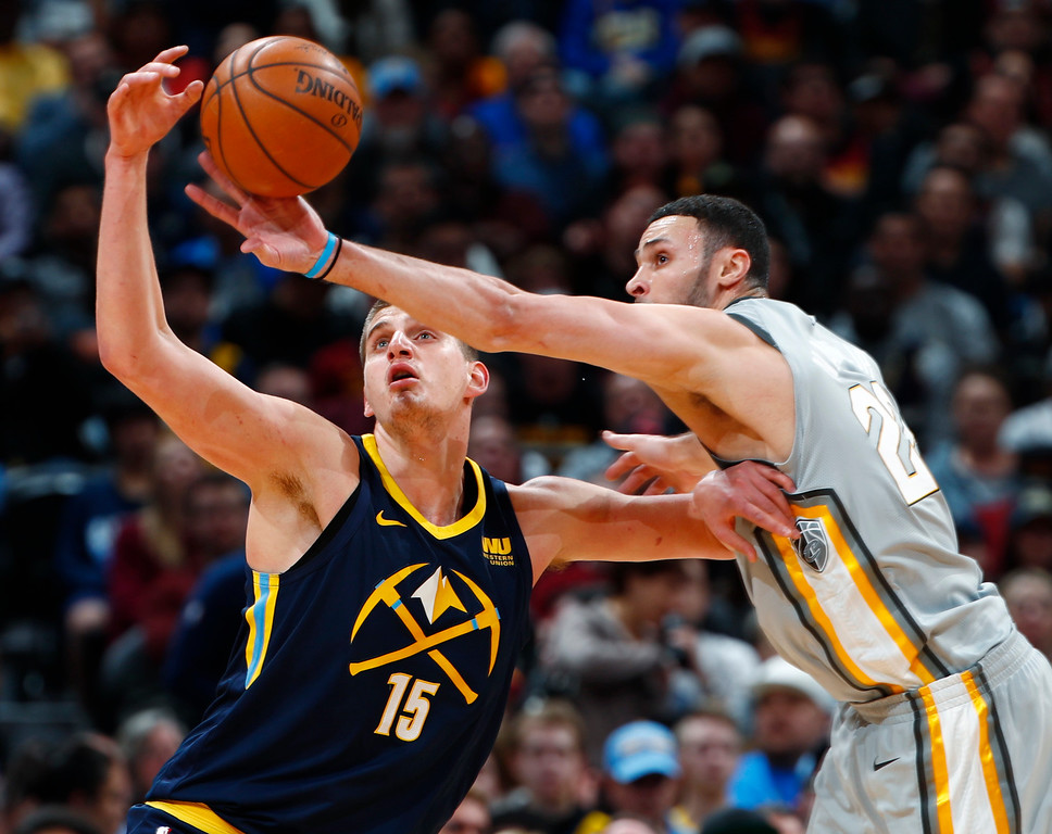 . Cleveland Cavaliers forward Larry Nance Jr., right, tips away a pass intended for Denver Nuggets center Nikola Jokic during the first half of an NBA basketball game Wednesday, March 7, 2018, in Denver. (AP Photo/David Zalubowski)