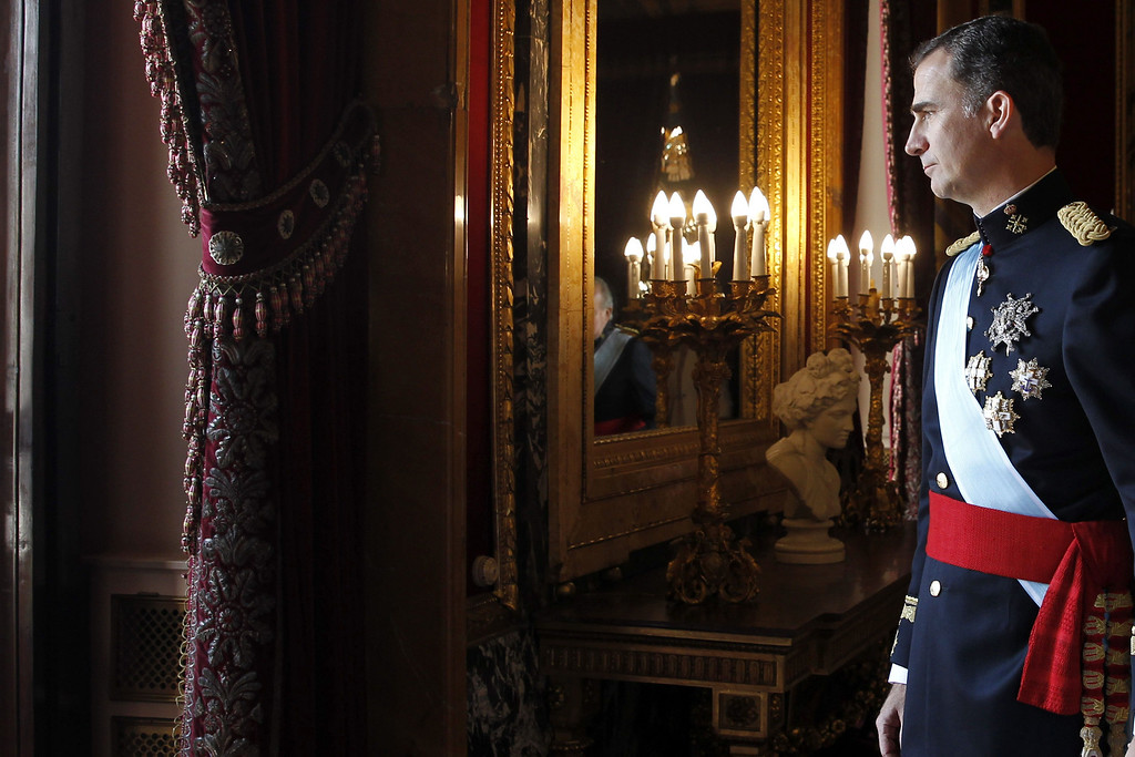 . Spain\'s King Felipe VI walks out to the balcony of the Palacio de Oriente or Royal Palace in Madrid on June 19, 2014 following a swearing in ceremony of Spain\'s new King before both houses of parliament.    AFP PHOTO / GERARD  LIZON/AFP/Getty Images