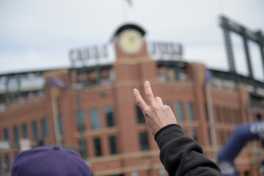 . A fan looks for tickets outside the stadium. The Colorado Rockies hosted the Arizona Diamondbacks in the Rockies season home opener at Coors Field in Denver, Colorado Friday, April 4, 2014. (Photo by Craig F. Walker/The Denver Post)