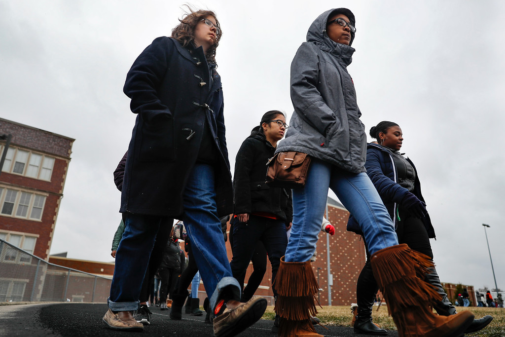 . Students gather on their soccer field during a 17-minute walkout protest at the Stivers School for the Arts, Wednesday, March 14, 2018, in Dayton, Ohio. Students across the country participated in walkouts Wednesday to protest gun violence, one month after the deadly shooting inside a high school in Parkland, Fla. (AP Photo/John Minchillo)