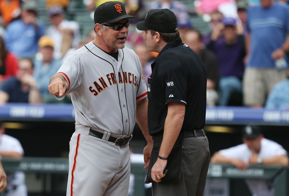 . San Francisco Giants manager Bruce Bochy, left, argues with home plate umpire Chris Conroy after Conroy ejected Bochy in the fourth inning of a baseball game against the Colorado Rockies in Denver, Wednesday, April 23, 2014. Bochy was ejected for arguing a called strike three on batter Brandon Hicks. (AP Photo/David Zalubowski)