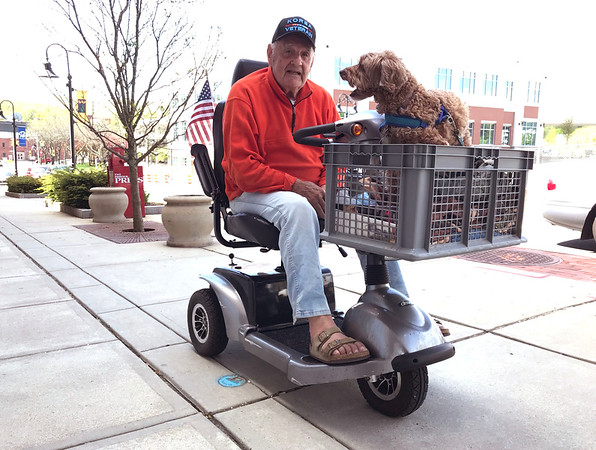 5/8/2019 Mike Orazzi | Staff John Lenk and his go Daisy,9, while riding up Main Street in downtown Bristol Wednesday morning.