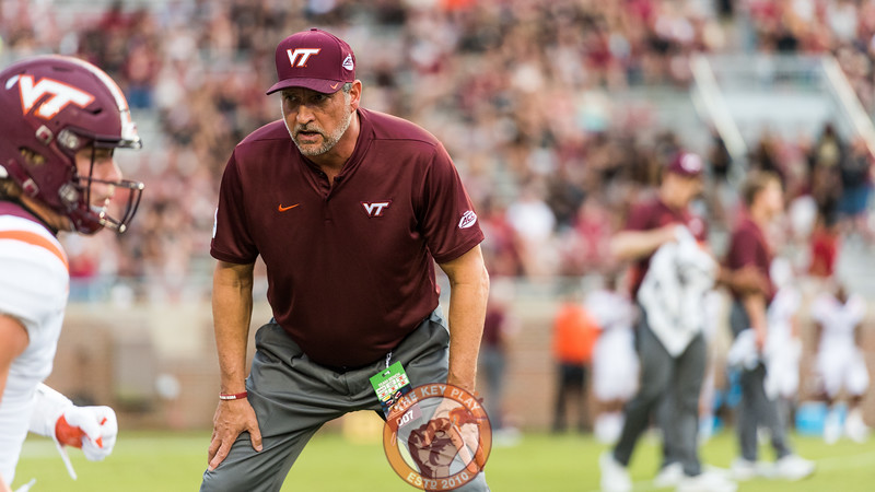 Bud Foster conducts warmups with the defense before the matchup between Virginia Tech and Florida State at Doak Campbell Stadium, Monday, Sept. 3, 2018. (Photo by Cory Hancock)