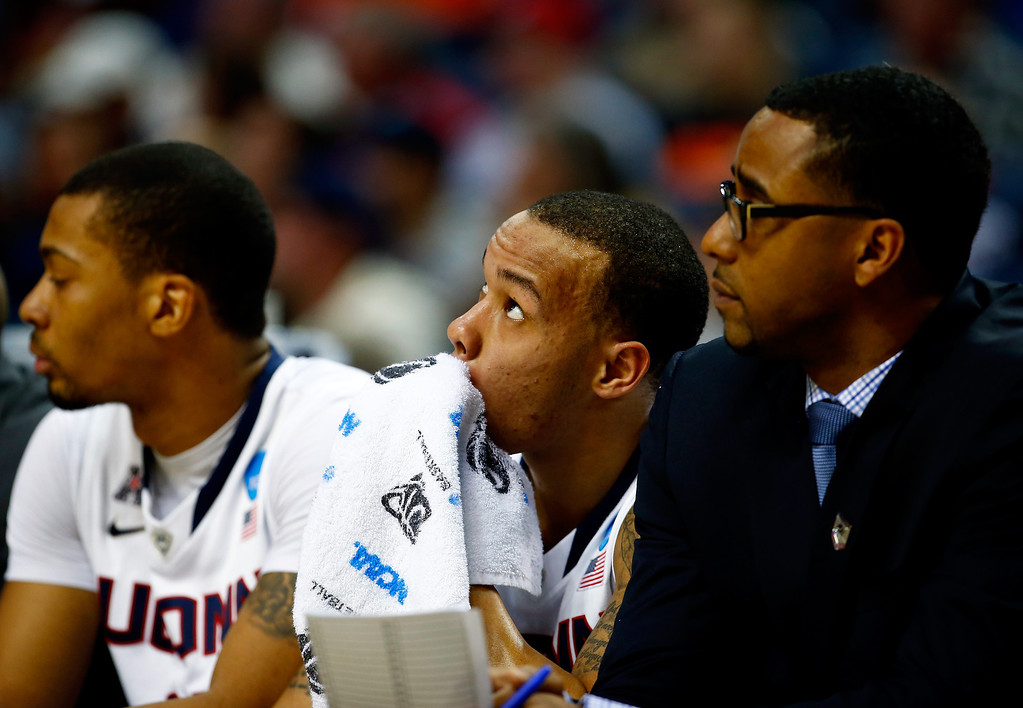 . BUFFALO, NY - MARCH 20: Shabazz Napier #13 of the Connecticut Huskies looks on from the bench during the second round of the 2014 NCAA Men\'s Basketball Tournament against the Saint Joseph\'s Hawks at the First Niagara Center on March 20, 2014 in Buffalo, New York.  (Photo by Jared Wickerham/Getty Images)