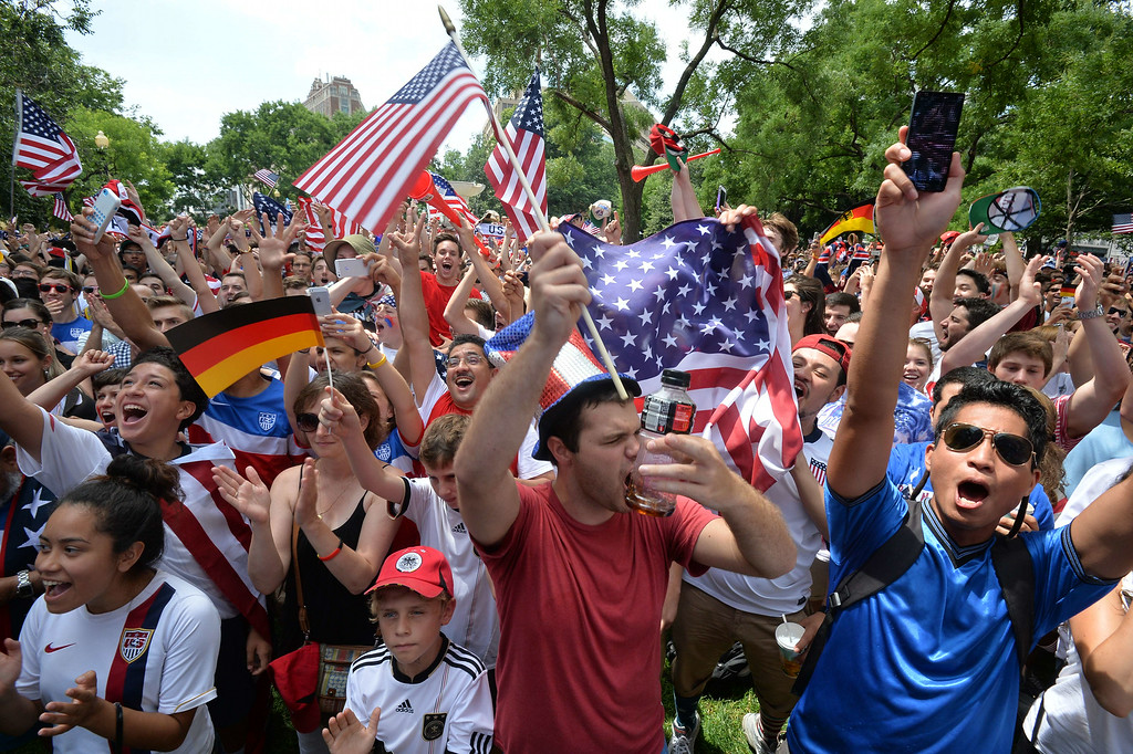 . US fans cheer as they await US play Germany in a 2014 FIFA World Cup Group G match, at Dupont Circle in Washington on June 26, 2014.   AFP PHOTO/Nicholas  KAMM/AFP/Getty Images