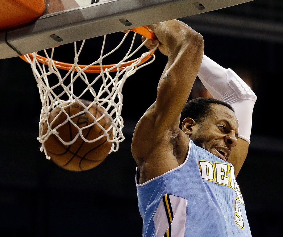. Denver Nuggets\' Andre Iguodala does a reverse dunk against the Milwaukee Bucks during the first half of an NBA basketball game, Monday, April 15, 2013, in Milwaukee. (AP Photo/Jeffrey Phelps)