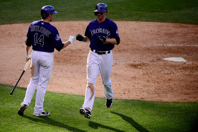 Description of . Josh Rutledge (14) of the Colorado Rockies fist bumps Charlie Blackmon (19) as he scores during the Dodgers' 10-8 win in Denver on Monday, September 2, 2013. The Colorado Rockies hosted the Los Angeles Dodgers at Coors Field. (Photo by AAron Ontiveroz/The Denver Post)