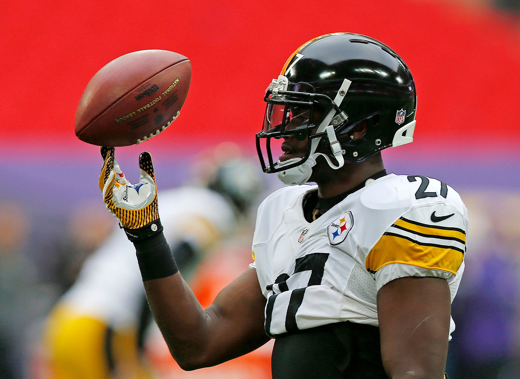 . Pittsburgh Steelers running back Jonathan Dwyer (27) holds a ball ahead of the NFL football game against Minnesota Vikings\' at Wembley Stadium, London, Sunday, Sept. 29, 2013.  (AP Photo/Sang Tan)