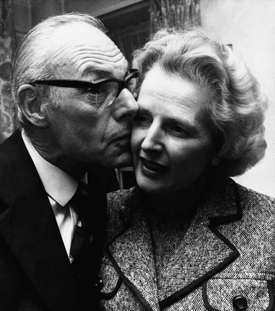 . In a Feb. 4, 1975 file photo, Margaret Thatcher gets a kiss  from her husband Denis in London, Feb. 4, 1975, after she had come out on top with 130 votes in the first round of the election for the Conservative party leadership. Thatchers former spokesman, Tim Bell, said that the former British Prime Minister Margaret Thatcher had died Monday morning, April 8, 2013, of a stroke.  She was 87 years old. (AP Photo/File)