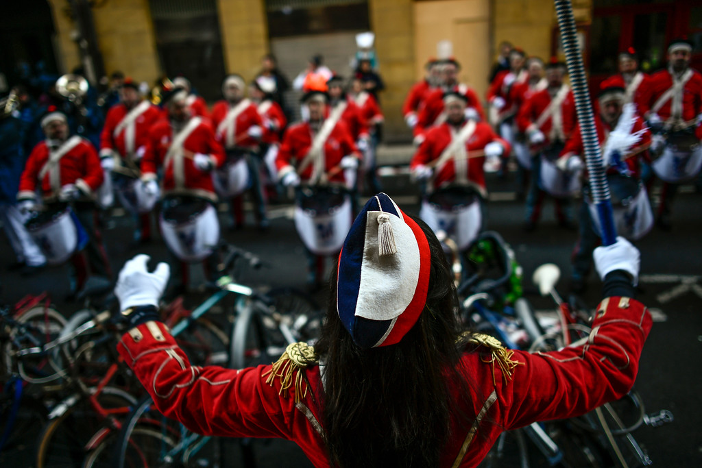 """. \""""Tamborilleros\"""" wearing their uniforms march in the traditional \'La Tamborrada\', during \'El Dia Grande\', the main day of San Sebastian feasts, in the Basque city of San Sebastian, northern Spain, Friday, Jan. 20, 2017. From midnight to midnight companies of perfectly uniformed marchers parade through the streets of San Sebastian playing drums and barrels in honor of their patron saint. (AP Photo/Alvaro Barrientos)"""