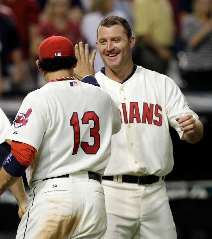 . Cleveland Indians\' Jim Thome, right, congratulates Asdrubal Cabrera after they defeated the Kansas City Royals 8-7 in a baseball game on Saturday, Aug. 27, 2011, in Cleveland. Cabrera hit a three-run home run off Royals relief pitcher Louis Coleman in the eight inning. (AP Photo/Tony Dejak)