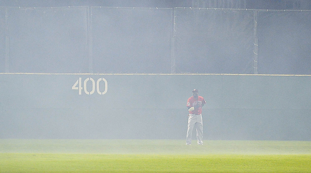 . A surprise batch of fireworks went off from the fire department training  tower beyond the outfield fence, causing a short delay in the game in the seventh inning. (Pioneer Press: Ben Garvin)
