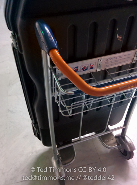 I found a cart, which was much easier on my back and arm- the case weighs 70lbs and has two wheels, so I end up shouldering most of the weight.