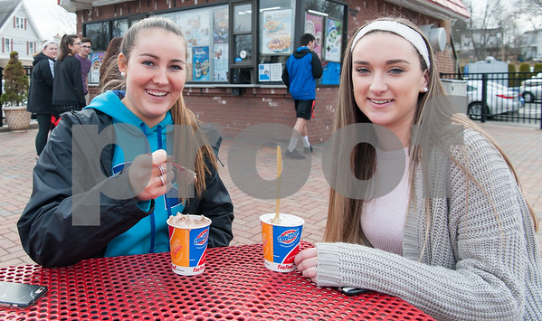03/01/18 Wesley Bunnell   Staff Berlin High students Katie O'Brien, L, and Jenna Cooney sit down with their blizzards at Dairy Queen in Kensington on its first day open for business in 2018.